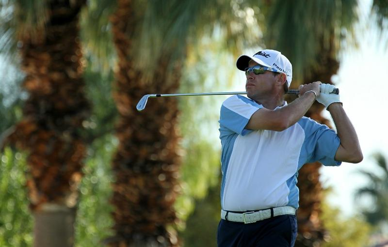 LA QUINTA, CA - JANUARY 19:  Brian Davis of England hits his tee shot on the third hole during round one of the Bob Hope Classic at the Palmer Private Course at PGA West on January 19, 2011 in La Quinta, California. (Photo by Stephen Dunn/Getty Images)