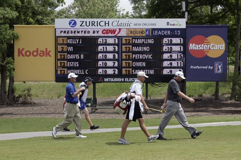 AVONDALE, LA - APRIL 26: Jerry Kelly, left, and Steve Marino, right, walk past the leader board on the 2nd fairway during the final round of the Zurich Classic at TPC Louisiana on April 26, 2009  in Avondale, Louisiana. (Photo by Dave Martin/Getty Images)