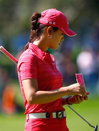 GUADALAJARA, MEXICO - NOVEMBER 15:  Michelle Wie of the United States looks at her book before her birdie putt on the third green during the final round of the Lorena Ochoa Invitational Presented by Banamex and Corona at Guadalajara Country Club on November 15, 2009 in Guadalajara, Mexico.  (Photo by Kevin C. Cox/Getty Images)