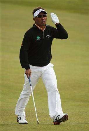 TURNBERRY, SCOTLAND - JULY 18:  Thongchai Jaidee of Thailand acknowledges the crowd during round three of the 138th Open Championship on the Ailsa Course, Turnberry Golf Club on July 18, 2009 in Turnberry, Scotland.  (Photo by Andrew Redington/Getty Images)