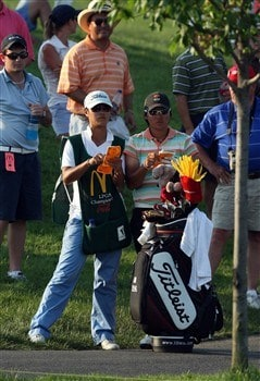 HAVRE DE GRACE, MD - JUNE 08:  Yani Tseng of Taiwan decides on her club for her second shot from the rough at the 18th hole, the first hole in the sudden death play-off after the final round of the 2008 McDonald's LPGA Championship held at Bulle Rock Golf Course, on June 8, 2008 in Havre de Grace, Maryland.  (Photo by David Cannon/Getty Images)