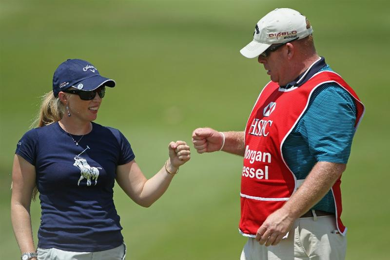 SINGAPORE - FEBRUARY 26:  Morgan Pressel of the USA celebrates with her caddie on the 16th hole during the third round of the HSBC Women's Champions at the Tanah Merah Country Club on February 26, 2011 in Singapore.  (Photo by Andrew Redington/Getty Images)