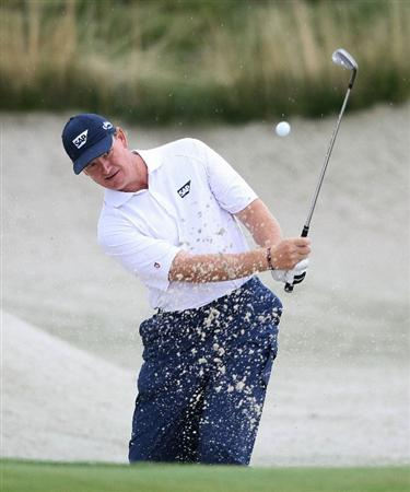 JERSEY CITY, NJ - AUGUST 28:  Ernie Els of South Africa hits out of the bunker on the 12th hole during round two of The Barclays on August 28, 2009 at Liberty National in Jersey City, New Jersey.  (Photo by Nick Laham/Getty Images)