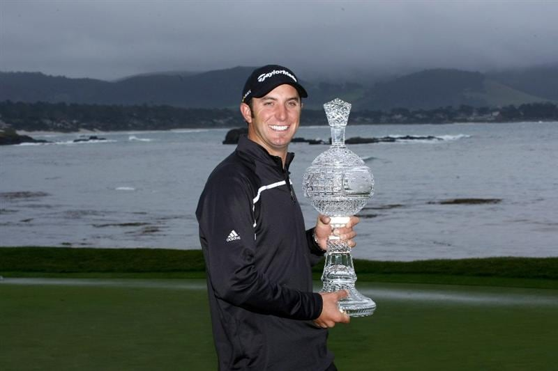 PEBBLE BEACH, CA - FEBRUARY 16:  Dustin Johnson poses with the trophy on th e18th green at Pebble Beach Golf Links after cancellation of the final round of the the AT&T Pebble Beach National Pro-Am on February 16, 2009 in Pebble Beach, California.  (Photo by Stephen Dunn/Getty Images)