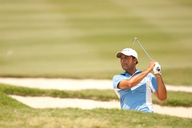IRVING, TX - MAY 28: Arjun Atwal follows through on a bunker shot during the third round of the HP Byron Nelson Championship at TPC Four Seasons at Las Colinas on May 28, 2011 in Irving, Texas. (Photo by Darren Carroll/Getty Images)