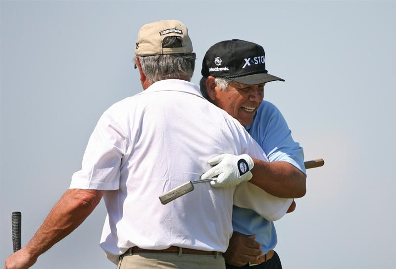 SAVANNAH, GA - APRIL 24 : Lee Trevino (R) hugs his playing partner Mike Hill (L) on the 18th hole during the first round of the Liberty Mutual Legends of Golf at the Westin Savannah Harbor Golf Resort and Spa on April 24, 2009 in Savannah, Georgia. (Photo by Hunter Martin/Getty Images)