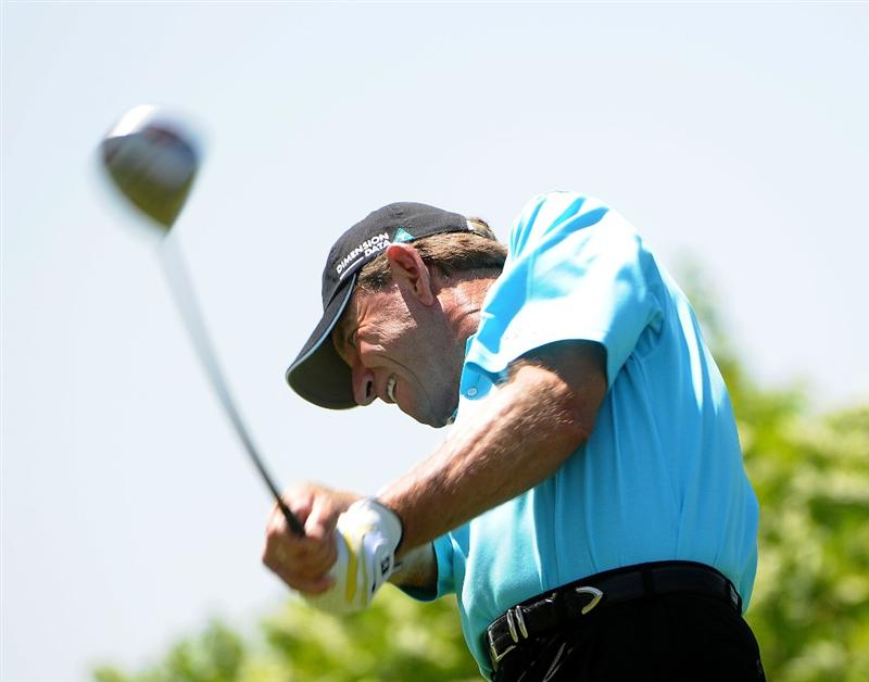 WEST DES MOINES IA. - MAY 29: Nick Price tees off the 6th hole during the first round of The Principal Charity Classic held at the Glen Oaks Country Club on May 29, 2009 in West Des Moines, Iowa. (Photo by Marc Feldman/Getty Images)