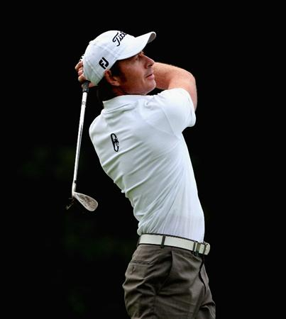 CRANS, SWITZERLAND - SEPTEMBER 03:  Brett Rumford of Australia plays his second shot on the 18th hole during the first round of The Omega European Masters at Crans-Sur-Sierre Golf Club on September 3, 2009 in Crans Montana, Switzerland.  (Photo by Andrew Redington/Getty Images)
