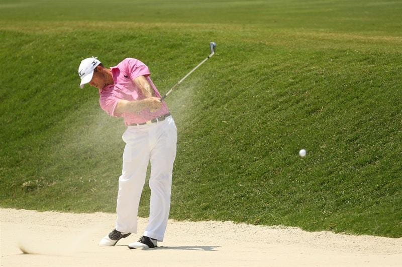 PONTE VEDRA BEACH, FL - MAY 13:  Jonathan Byrd hits from a fairway bunker on the fifth hole during the second round of THE PLAYERS Championship held at THE PLAYERS Stadium course at TPC Sawgrass on May 13, 2011 in Ponte Vedra Beach, Florida.  (Photo by Mike Ehrmann/Getty Images)