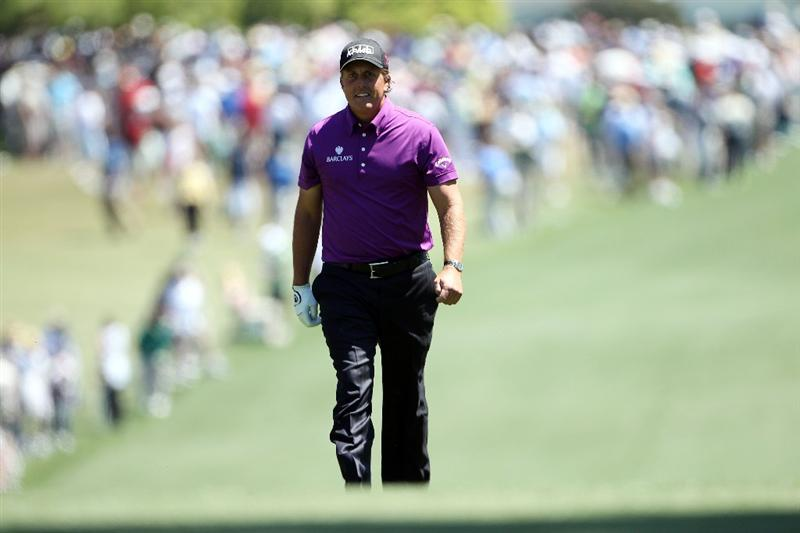 AUGUSTA, GA - APRIL 07:  Phil Mickelson walks up the first hole during the first round of the 2011 Masters Tournament at Augusta National Golf Club on April 7, 2011 in Augusta, Georgia.  (Photo by Andrew Redington/Getty Images)