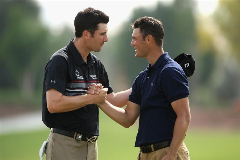 DUBAI, UNITED ARAB EMIRATES - NOVEMBER 22:  Ross Fisher of England (L) shakes hands with Martin Kaymer of Germany on the 18th green during the final round of the Dubai World Championship on the Earth Course, Jumeirah Golf Estates on November 22, 2009 in Dubai, United Arab Emirates.  (Photo by Andrew Redington/Getty Images)