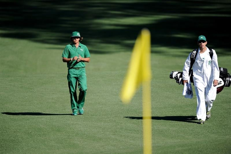 AUGUSTA, GA - APRIL 07:  Rickie Fowler walks with his caddie Joe Skovron to the second green during the first round of the 2011 Masters Tournament at Augusta National Golf Club on April 7, 2011 in Augusta, Georgia.  (Photo by Harry How/Getty Images)