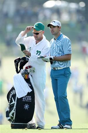 AUGUSTA, GA - APRIL 08:  Oliver Wilson of England waits with his caddie Richard Hill on the first hole during the first round of the 2010 Masters Tournament at Augusta National Golf Club on April 8, 2010 in Augusta, Georgia.  (Photo by Andrew Redington/Getty Images)