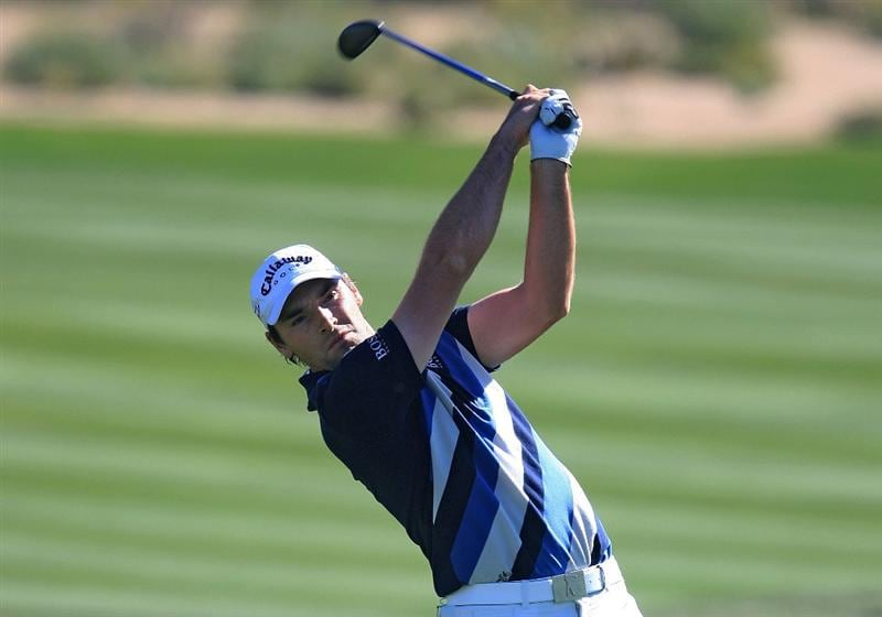 MARANA, AZ - FEBRUARY 26:  Oliver Wilson of England hits his approach shot on the second hole during the second round of the Accenture Match Play Championship at the Ritz-Carlton Golf Club at Dove Mountain on February 26, 2009 in Marana, Arizona.  (Photo by Scott Halleran/Getty Images)