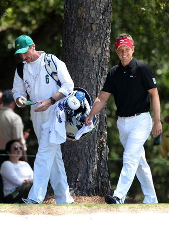 AUGUSTA, GA - APRIL 07:  Luke Donald of England walks with his caddie John McLaren on the first hole during the first round of the 2011 Masters Tournament at Augusta National Golf Club on April 7, 2011 in Augusta, Georgia.  (Photo by Andrew Redington/Getty Images)