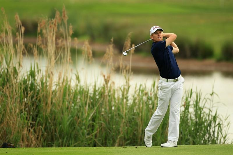 NEWPORT, WALES - JUNE 05:  Andrew Dodt of Australia plays his second shot into the 14th green during the third round of the Celtic Manor Wales Open on The Twenty Ten Course on June 5, 2010 in Newport, Wales.  (Photo by Warren Little/Getty Images)