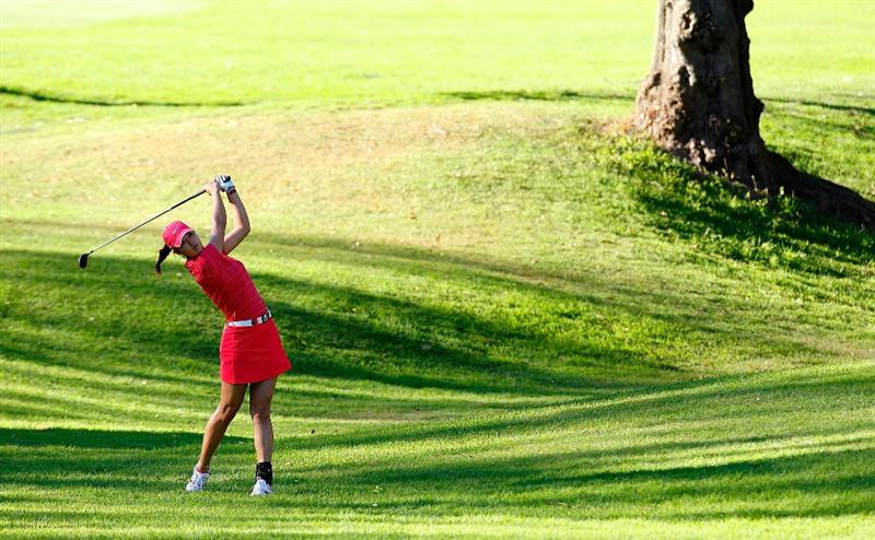 GUADALAJARA, MEXICO - NOVEMBER 15:  Michelle Wie of the United States plays her second shot on the 18th hole during the final round of the Lorena Ochoa Invitational Presented by Banamex and Corona at Guadalajara Country Club on November 15, 2009 in Guadalajara, Mexico.  (Photo by Kevin C. Cox/Getty Images)
