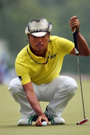 AUGUSTA, GA - APRIL 11:  Shingo Katayama of Japan lines up a putt on the first hole during the third round of the 2009 Masters Tournament at Augusta National Golf Club on April 11, 2009 in Augusta, Georgia.  (Photo by Andrew Redington/Getty Images)