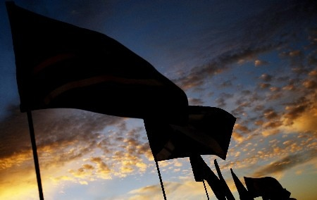 MARANA, AZ - FEBRUARY 20:  Flags wave on the range during sunrise before the first round matches of the WGC-Accenture Match Play Championship at The Gallery at Dove Mountain on February 20, 2008 in Marana, Arizona.  (Photo by Travis Lindquist/Getty Images)