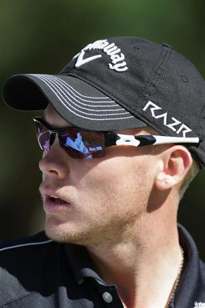 VIRGINIA WATER, ENGLAND - MAY 25:  Danny Willett of England looks on during the Pro-Am round prior to the BMW PGA Championship at Wentworth Club on May 25, 2011 in Virginia Water, England.  (Photo by Ross Kinnaird/Getty Images)