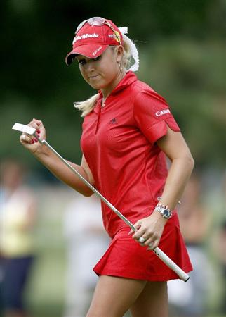 SYLVANIA, OH - JULY 03: Natalie Gulbis reacts to a birdie putt on the 17th green during the second round of the Jamie Farr Owens Corning Classic at Highland Hills Golf Club on July 3, 2009 in Sylvania, Ohio. (Photo by Gregory Shamus/Getty Images)