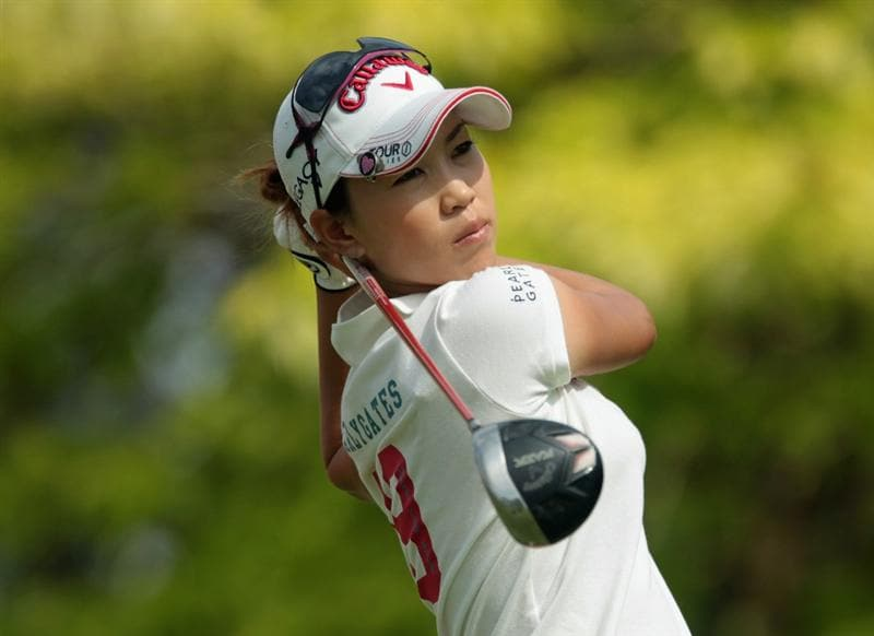 SINGAPORE - FEBRUARY 26:  Momoko Ueda of Japan watches her tee shot on the sixth hole during the third round of the HSBC Women's Champions 2011 at the Tanah Merah Country Club on February 26, 2011 in Singapore, Singapore.  (Photo by Scott Halleran/Getty Images)