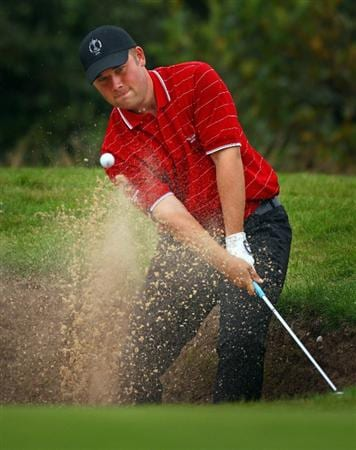 DUMBARTON, SCOTLAND - SEPTEMBER 18:  Craig Matheson of Great Britain play's out the bunker on the 8th green in the afternoon four ball matches at The Carrick on Loch Lomond on September 18, 2009 in Dumbarton, Scotland.  (Photo by Jeff J Mitchell/Getty Images)