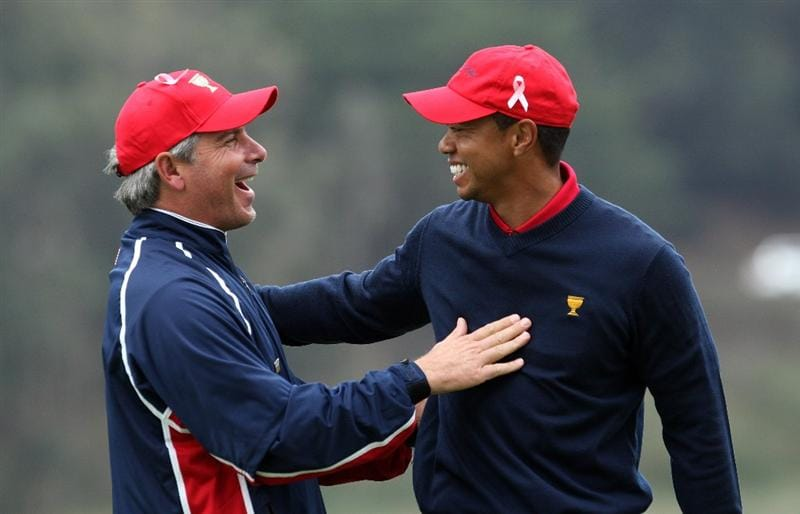 SAN FRANCISCO - OCTOBER 11:  Fred Couples the Captain of the USA Team races to congratulate Tiger Woods after he had holed the winning putt at the 13th hole where he beat his opponent Y.E.Yang 6&5 during the Day Four Singles Matches in The Presidents Cup at Harding Park Golf Course on October 10, 2009 in San Francisco, California  (Photo by David Cannon/Getty Images)