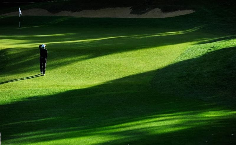 PARIS - SEPTEMBER 26:  Chris Wood of England walks on the first hole during the final round of the Vivendi cup at Golf de Joyenval on September 26, 2010 in Chambourcy, near Paris, France.  (Photo by Stuart Franklin/Getty Images)