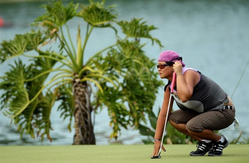 SINGAPORE - FEBRUARY 26:  Christina Kim of the USA lines up a putt on the 18th hole during the second round of the HSBC Women's Champions at the Tanah Merah Country Club on February 26, 2010 in Singapore.  (Photo by Andrew Redington/Getty Images)