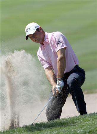 PALM HARBOR, FL - MARCH 20:  Trevor Immelman of South Africa plays a shot on the 1st hole during the final round of the Transitions Championship at Innisbrook Resort and Golf Club on March 20, 2011 in Palm Harbor, Florida.  (Photo by Sam Greenwood/Getty Images)