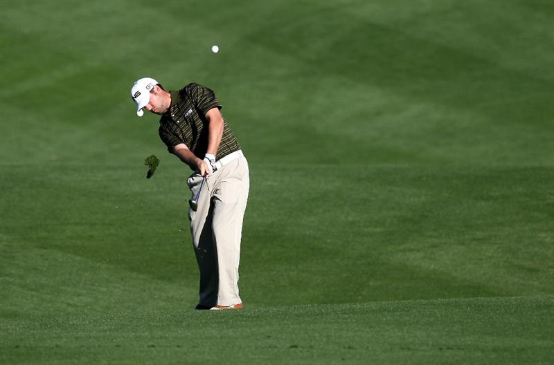 LA QUINTA, CA - JANUARY 24:  Alex Prugh hits his second shot on the 10th hole at SilverRock Resort during the fourth round of the Bob Hope Classic on January 24, 2010 in La Quinta, California.  (Photo by Stephen Dunn/Getty Images)