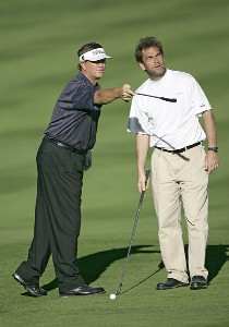 Peter Jacobsen gives some advice to Huey Lewis during the first round of the  AT&T Pebble Beach National Pro-Am t the Spyglass Hill Golf Course  in Pebble Beach, California on February 9, 2006.Photo by Sam Greenwood/WireImage.com