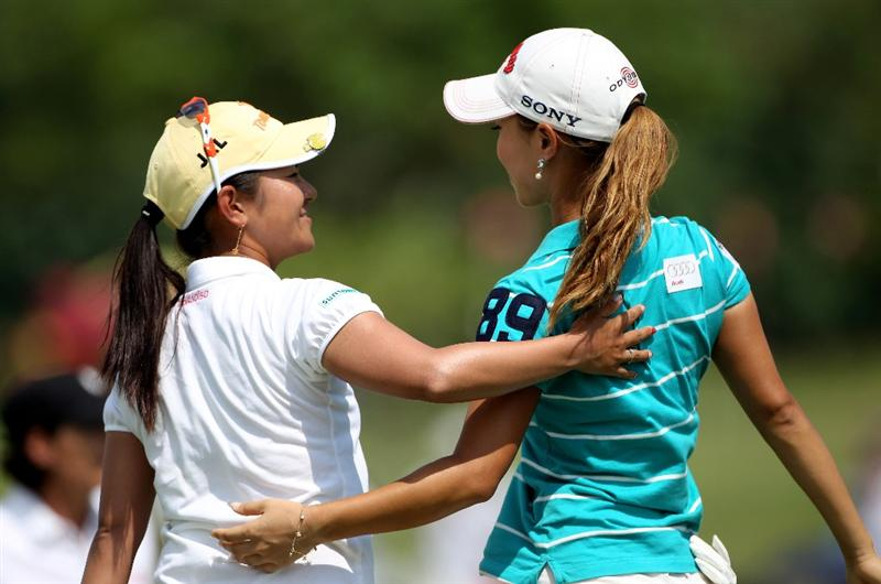 SINGAPORE - FEBRUARY 28:  Ai Miyazato of Japan (left) is congratulated by Momoko Ueda of Japan on the 18th green after winning the HSBC Women's Champions at the Tanah Merah Country Club on February 28, 2010 in Singapore.  (Photo by Andrew Redington/Getty Images)