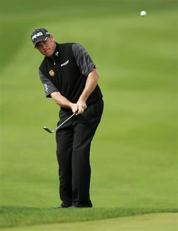 DOHA, QATAR - FEBRUARY 03:  Lee Westwood of England plays his third shot on the first hole during the first round of the Commercialbank Qatar Masters held at Doha Golf Club on February 3, 2011 in Doha, Qatar.  (Photo by Andrew Redington/Getty Images)