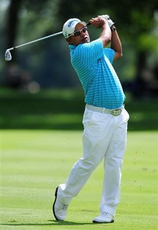 AKRON, OH - AUGUST 07:   Prayad Marksaeng of Thailand plays his approach shot on the 13th hole during the second round of the World Golf Championship Bridgestone Invitational on August 7, 2009 at Firestone Country Club in Akron, Ohio.  (Photo by Stuart Franklin/Getty Images)