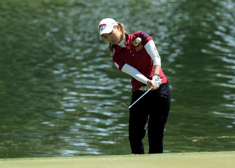 RANCHO MIRAGE, CA - APRIL 1:  Momoko Ueda of Japan chips onto the sixth green during the first round of the Kraft Nabisco Championship at Mission Hills Country Club on April 1, 2010 in Rancho Mirage, California.  (Photo by Stephen Dunn/Getty Images)