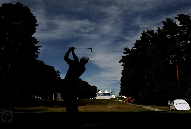 VIRGINIA WATER, ENGLAND - MAY 25:  Graeme McDowell of Northern Ireland tees off on the 14th hole during the Pro-Am round prior to the BMW PGA Championship at Wentworth Club on May 25, 2011 in Virginia Water, England.  (Photo by Ross Kinnaird/Getty Images)