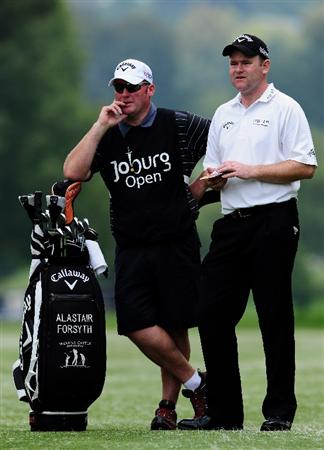 JOHANNESBURG, SOUTH AFRICA - JANUARY 14:  Alastair Forsyth of Scotland and caddie during the first round of the Joburg Open at Royal Johannesburg and Kensington Golf Club on January 14, 2010 in Johannesburg, South Africa.  (Photo by Stuart Franklin/Getty Images)