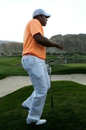 LA QUINTA, CA - JANUARY 23:  Jhonattan Vegas of Venezuela runs up a mound to see the result of his pitch shot onto the green on the first playoff hole during the final round of the Bob Hope Classic on the Palmer Private Course at PGA West on January 23, 2011 in La Quinta, California.  Vegas went on to win on the second playoff hole.  (Photo by Stephen Dunn/Getty Images)