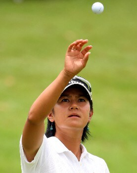 SINGAPORE - MARCH 02:  Ai Miyazato of Japan catches her golf ball on the ninth green during the final round of the HSBC Women's Champions at Tanah Merah Country Club on March 2, 2008 in Singapore.  (Photo by Andrew Redington/Getty Images)