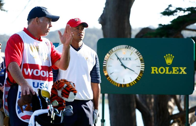 SAN FRANCISCO - OCTOBER 09:  Tiger Woods of the USA Team waits with his caddie Steve Williams on the 14th tee during the Day Two Fourball Matches of The Presidents Cup at Harding Park Golf Course on October 9, 2009 in San Francisco, California.  (Photo by Scott Halleran/Getty Images)