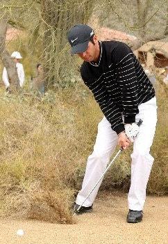 MARANA, AZ - FEBRUARY 22:  Paul Casey of England hits a shot from the sand on the first hole during the third round matches of the WGC-Accenture Match Play Championship at The Gallery at Dove Mountain on February 22, 2008 in Marana, Arizona.  (Photo by Scott Halleran/Getty Images)