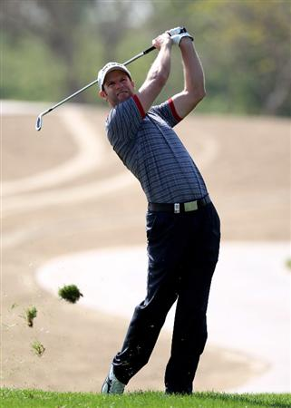 ABU DHABI, UNITED ARAB EMIRATES - JANUARY 23:  Bradley Dredge of Wales on the par four 13th hole during the third round of the Abu Dhabi Golf Championship at the Abu Dhabi Golf Club on January 23, 2010 in Abu Dhabi, United Arab Emirates.  (Photo by Ross Kinnaird/Getty Images)