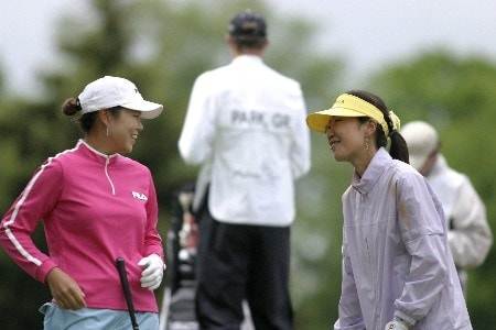 Hee-Won Han and Soo-Yun Kang share a laugh before play at the Sybase Classic Sunday at the Wykagyl Country Club in New Rochelle, NY.Photo by Patrick Tuohy/WireImage.com