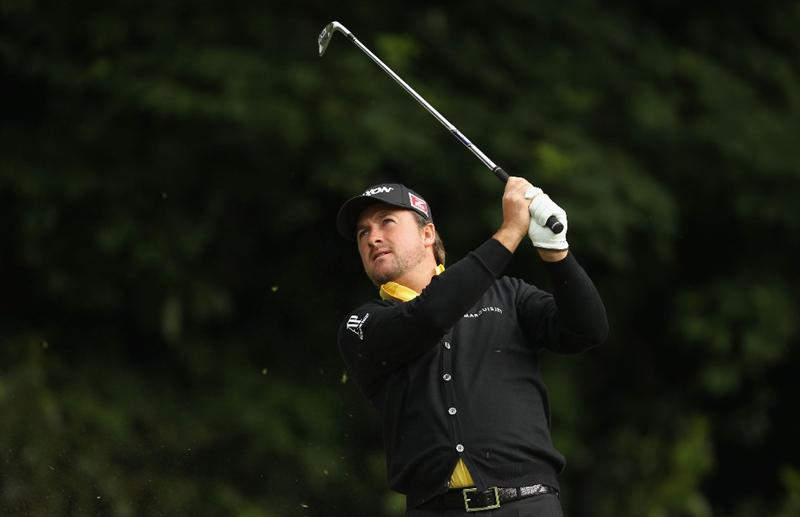 VIRGINIA WATER, ENGLAND - MAY 26:  Graeme McDowell of Northern plays an approach shot during the first round of the BMW PGA Championship at Wentworth Club on May 26, 2011 in Virginia Water, England.  (Photo by Ian Walton/Getty Images)