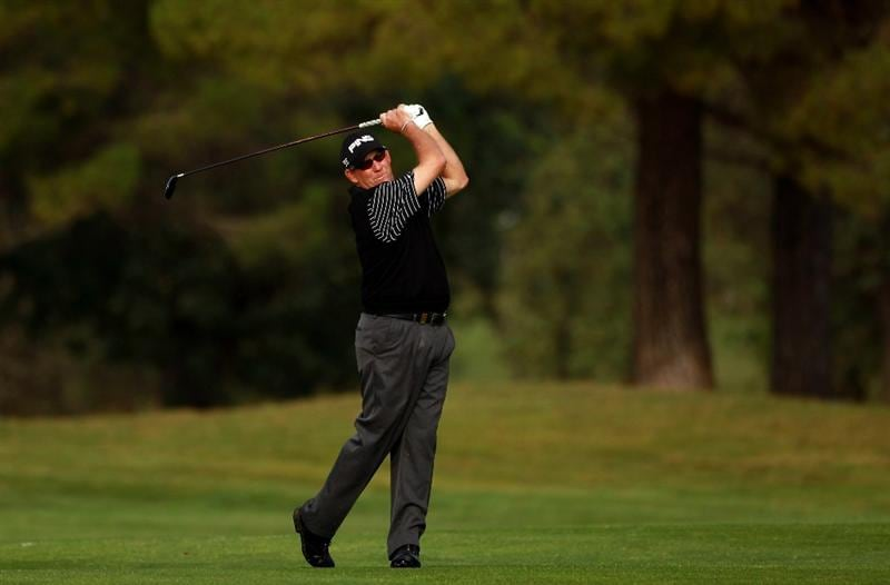 CASTELLON DE LA PLANA, SPAIN - NOVEMBER 05:  Mike Cunning of the USA plays his second shot into the fifth green during the first round of the OKI Castellon Senior Tour Championships at Club de Campo del Mediteraneo on November 5, 2010 in Castellon de la Plana, Spain.  (Photo by Warren Little/Getty Images)
