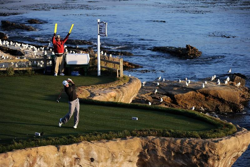 PEBBLE BEACH, CA - JUNE 19:  Dustin Johnson watches his tee shot on the 18th hole during the third round of the 110th U.S. Open at Pebble Beach Golf Links on June 19, 2010 in Pebble Beach, California.  (Photo by Harry How/Getty Images)