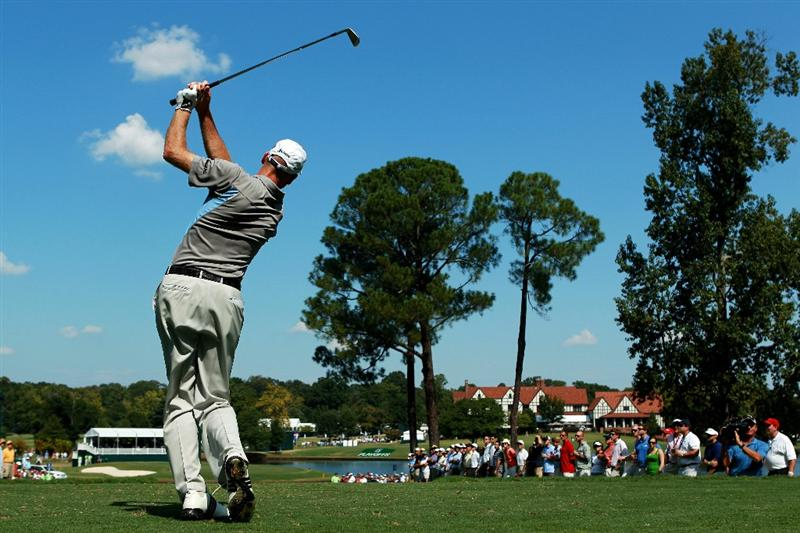 ATLANTA - SEPTEMBER 25: Jim Furyk hits his tee shot on the sixth hole during the third round of THE TOUR Championship presented by Coca-Cola at East Lake Golf Club on September 25, 2010 in Atlanta, Georgia.  (Photo by Scott Halleran/Getty Images)