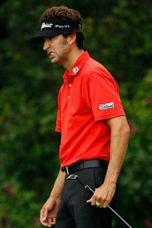 GRAND BLANC, MI - AUGUST 01:  Michael Letzig reacts to a missed putt on the 15th hole during round three of the Buick Open at Warwick Hills Golf and Country Club on August 1, 2009 in Grand Blanc, Michigan.  (Photo by Chris Graythen/Getty Images)